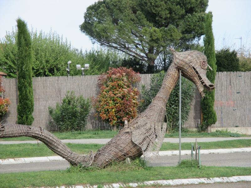 Tarasque - according to legend this monster, half-animal and half-fish, terrorized the countryside.  It was tamed by Sainte Marthe who is buried at the town of Tarascon.