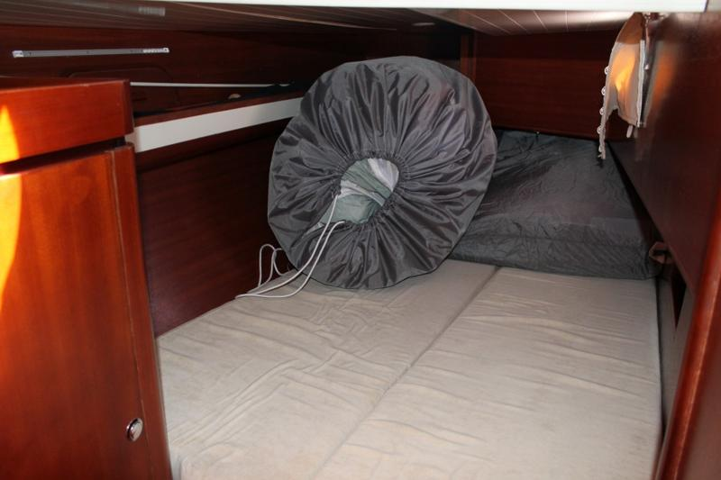 Main sail and spinnaker in the aft cabin.  Genoa stowed in the forward compartment on deck.