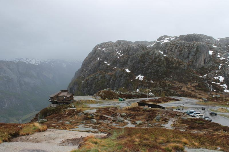Parking lot and restaurant (overhanging fjord view) at Kjerag trailhead.